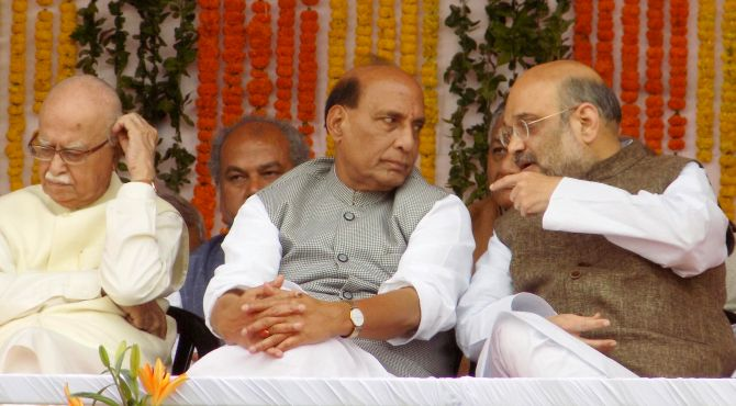 Bharatiya Janata Party President Amit Shah, right, with Home Minister Rajnath Singh, the BJP's tallest leader in UP who reportedly was forced to play a cameo role in the 2017 election campaign, as BJP veteran L K Advani, left, seems thoughtful at the UP chief minister's swearing in ceremony in Lucknow, March 19, 2017. Photograph: Sandeep Pal