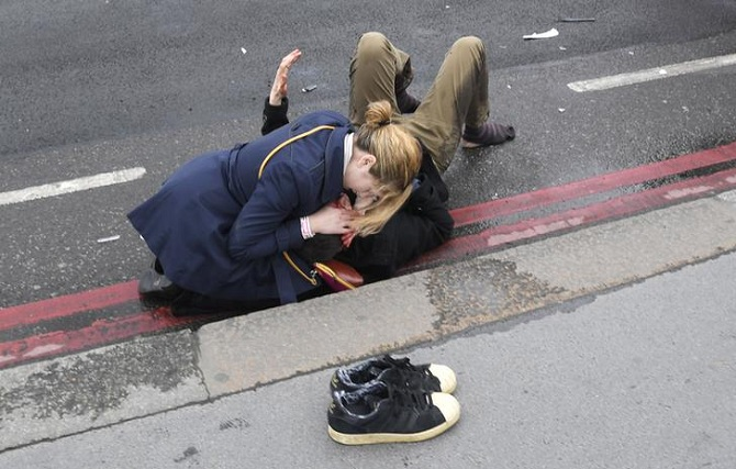 People help an injured person outside Westminister