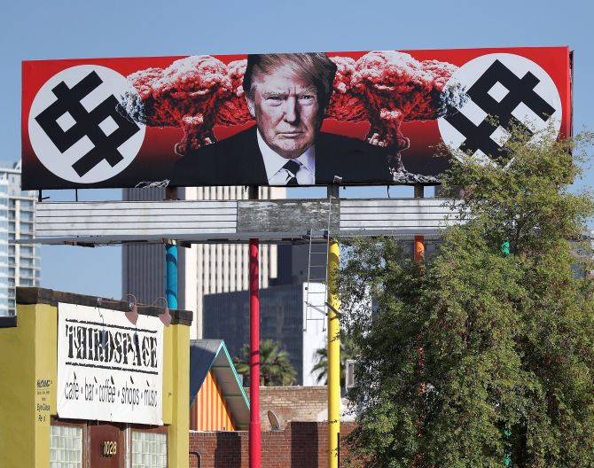 Now, a US billboard shows Trump with swastika-like symbols