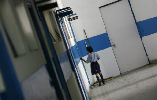 A student enters the bathroom at a school for the visually impaired, New Delhi, April 9, 2009. Photo: Adnan Abidi/Reuters