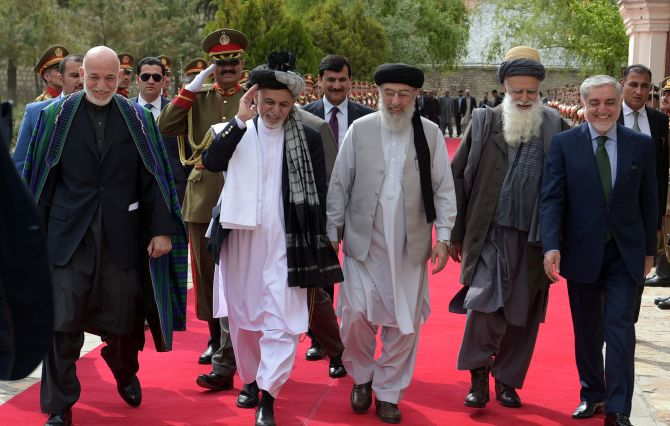 From left to right: Former Afghan President Hamid Karzai, Afghan President Ashraf Ghani, warlord Gulbuddin Hekmatyar, former jihadi leader Abdul Rabb Rasool Sayyaf and Afghanistan Chief Executive Abdullah Abdullah attend a ceremony at the presidential palace in Kabul, May 4, 2017. Photograph: Shah Marai/Reuters