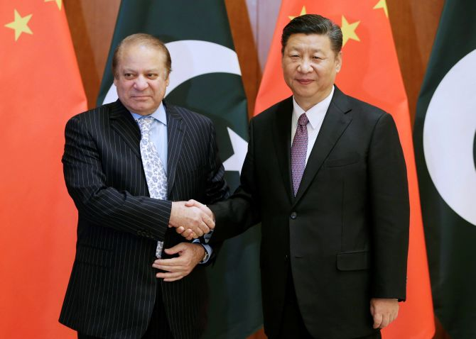 Pakistan Prime Minister Nawaz Sharif, left, with Chinese President Xi Jinping ahead of the Belt and Road Forum in Beijing. Photograph: Jason Lee/Reuters