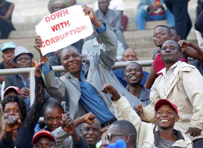 Zimbabwe's 'Crocodile' Mnangagwa sworn in as new leader - Rediff com