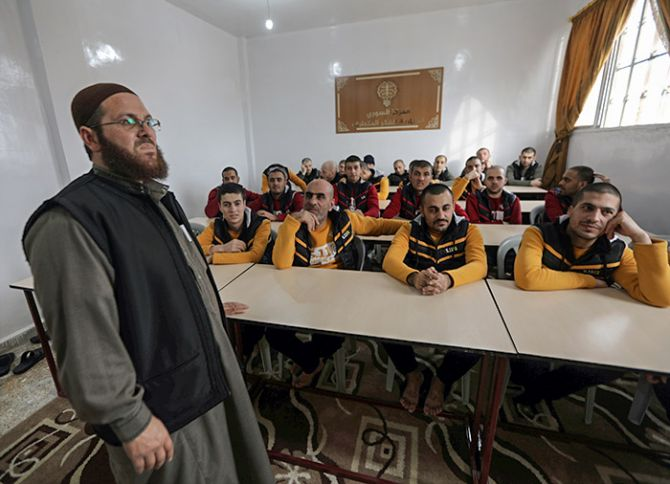 Former Islamic State members in a classroom at the Syrian Centre for Combating Extremist Ideology in the town of Marea in northern Aleppo, Syria, November 2, 2017. Photograph: Khalil Ashawi/Reuters