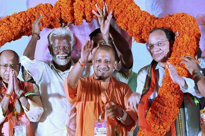 Uttar Pradesh Chief Minister Yogi Adityanath, BJP Kerala President Kummanam Rajasekharan to his right, and other party leaders at a rally in Kannur, Kerala, October 5, 2017. Photograph: PTI Photo