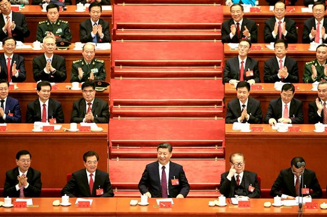Xi Jinping, centre, flanked by from left, Zhang Dejiang, chairman of the standing committee of the National People's Congress, former Chinese presidents Hu Jintao and Jiang Zemin, and Chinese Premier Li Keqiang, at the opening of the 19th National Congress of the Communist Party of China at the Great Hall of the People in Beijing, October 18, 2017. Photograph: Aly Song/Reuters