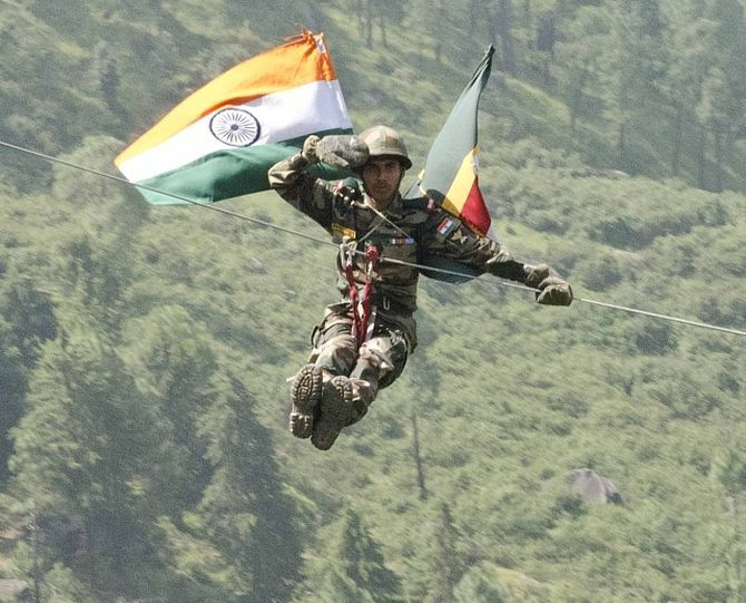 An Indian soldier with 12 Madras zip lines off a cliff at Chaubattia Military Station. This was part of a rappelling and a skirmish order demonstration for US and Indian soldiers during Yudh Abhyas 2016. Photograph: Staff Sgt Samuel Northrup/US Army photo