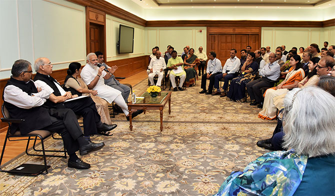 Prime Minister Narendra D Modi, flanked by External Affairs Minister Sushma Swaraj and Surface Transport Minister Nitin J Gadkari, interacts with a group of additional secretaries and joint secretaries in New Delhi, September 1, 2017.