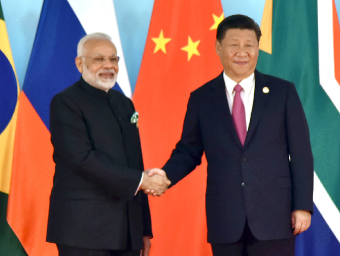 Prime Minister Narendra D Modi is welcomed by Chinese President Xi Jinping at the 9th BRICS summit in Xiamen, September 4, 2017. Photograph: Press Information Bureau