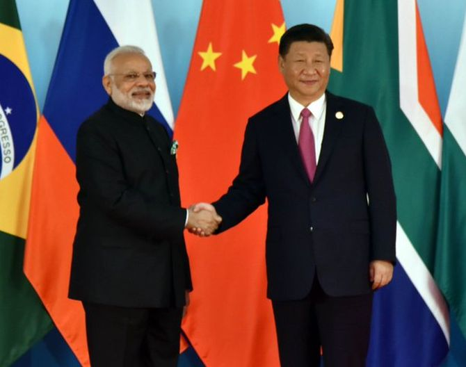 PM, Xi display bonhomie at BRICS Summit