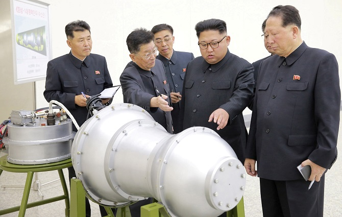 Kim Jong Un inspects a nuclear device in Pyongyang, September 3, 2017. Photograph: KCNA via Reuters