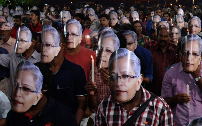Attendees wear Gauri Lankesh masks at a condolence meeting for the fearless journalist who was murdered outside her home in Bengaluru on September 5, 2017.