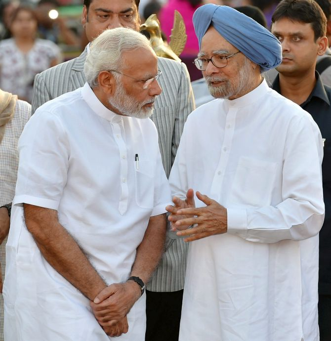 Prime Minister Narendra D Modi with former prime minister Dr Manmohan Singh at the Dussehra celebrations at the Parade Ground, New Delhi, September 30, 2017. Photograph: Kamal Kishore/PTI Photo