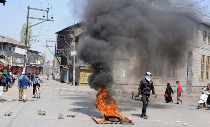 Clashes erupted in Srinagar between locals and security forces following encounters in Shopian and Anantnag, April 1, 2018. Photograph: Umar Ganie for Rediff.com