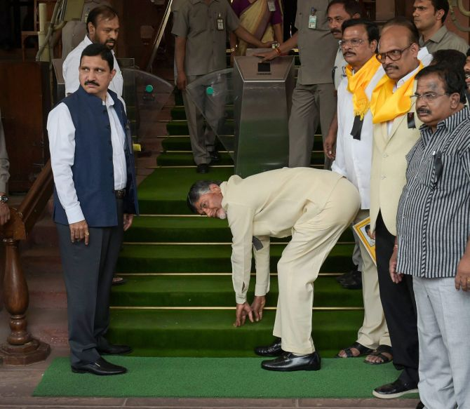 April 3, 2018. On his first visit to New Delhi after breaking away from the NDA, Andhra Pradesh Chief Minister Nara Chandrababu Naidu touched the stairs before entering Parliament. Naidu's act wass reminiscent of what Prime Minister Narendra Damodardas Modi did when he entered Parliament for the first time as a MP in 2014. Photograph: Shahbaz Khan/PTI Photo