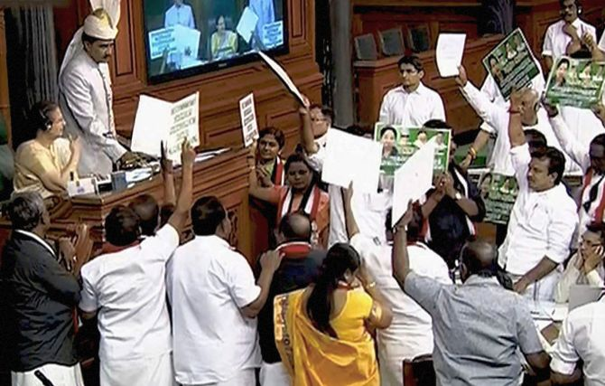 Lok Sabha Speaker Sumitra Mahajan speaks to Opposition MPs during a disruption in Parliament during the Budget session in April 2018. Photograph: PTI Photo