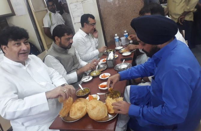 A photograph of Congress leaders in Delhi eating before sitting on a fast was circulated on social media, April 9, 2018. Photograph: ANI