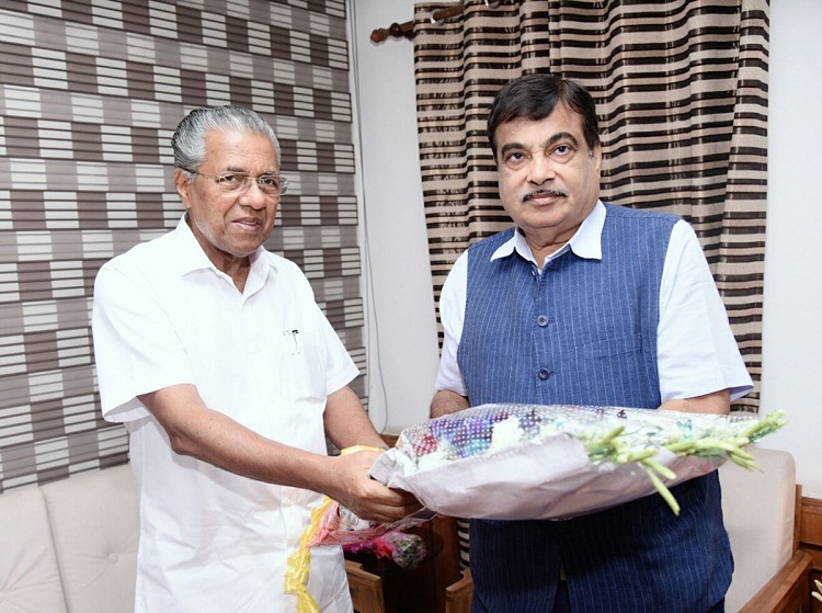Kerala Chief Minister Pinarayi Vijayan, left, with Union Minister Nitin Gadkari in Thiruvanathapuram, March 28, 2018.