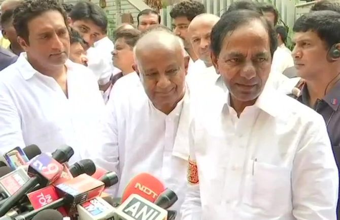 Former prime minister H D Deve Gowda, centre, with Telangana Chief Minister K Chandrasekhar Rao, right. Photograph: ANI