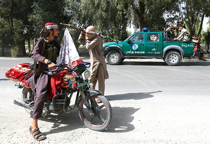 Afghan security forces and Taliban terrorists cross each other warily during a ceasefire in Bati Kot district, Nangarhar province, Afghanistan, June 16, 2018. Photograph: Parwiz/Reuters