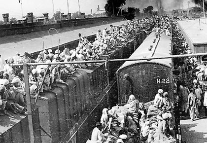 Sikhs flock aboard a train to India to escape the violence of the Partition riots after the bifurcation of Punjab