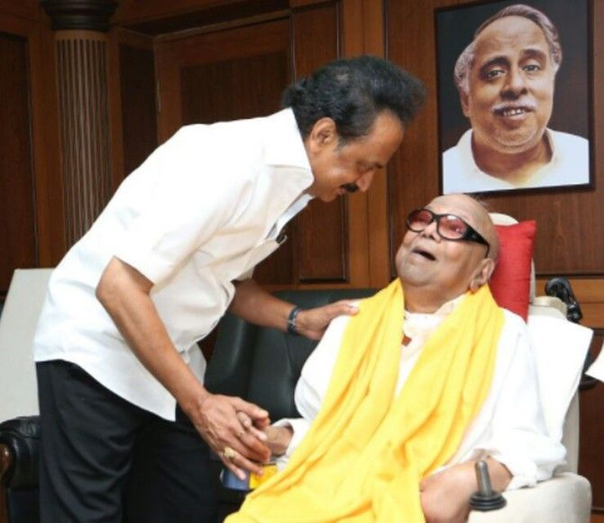 M K Stalin, who now heads the DMK, with his father M Karunanidhi under the watchful gaze of the party's legendary founder C N Annadurai