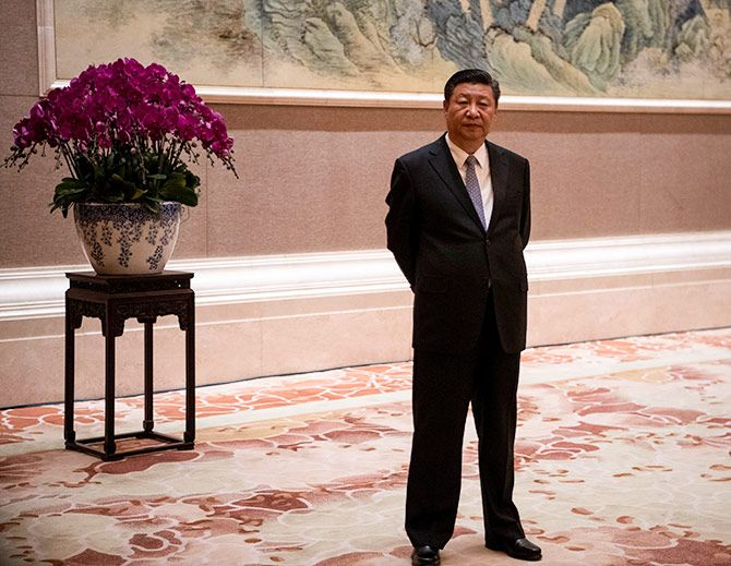 China's supreme leader Xi Jinping waits for Papua New Guinea Prime Minister Peter O'Neill at the Diaoyutai state guesthouse in Beijing, June 21, 2018. Photograph: Fred Dufour/Reuters