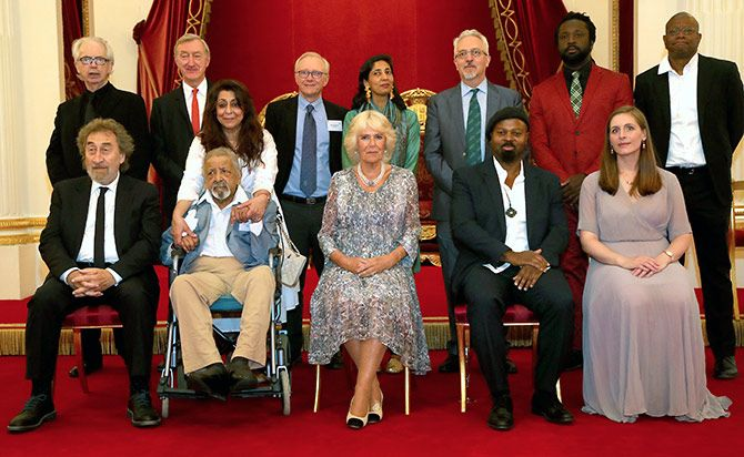 Sir V S Naipaul and Lady Nadira with the Duchess of Cornwall and other Man Booker Prize winners: (Back row, left to right) Peter Carey, Julian Barnes, David Grossman (a former Man Booker International winner), Kiran Desai, Alan Hollinghurst, Marlon James, Paul Beatty; (front row, left to right) Howard Jacobson, V S Naipaul (accompanied by his wife Nadira), Ben Okri and Eleanor Catton at a reception celebrating the 50th anniversary of the Man Booker Prize at Buckingham Palace, July 5, 2018. Photograph: Gareth Fuller/Reuters
