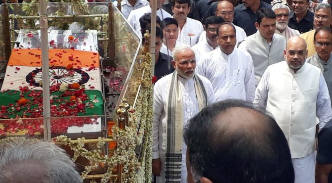 Prime Minister Narendra Damodardas Modi and Bharatiya Janata Party President Amit Anilchandra Shah walk alongside the late former prime minister Atal Bihari Vajpayee's funeral procession in New Delhi, August 17, 2018. Photograph: ANI.