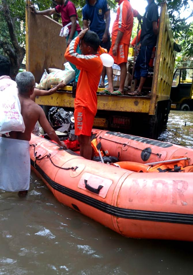 NDRF personnel and local villagers provide assistance