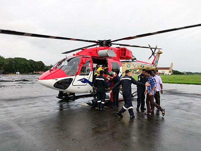Rescued citizens getting off at the helipad