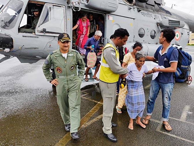 Wing Commander Shivang Kumar at the base of his chopper.
