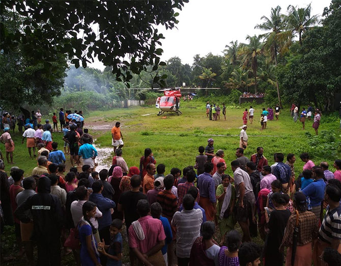 An IAF helicopter lands at the make-shift helipad made by Basil George and locals