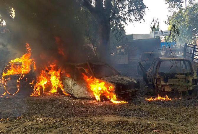 Vehicles set on fire by a mob during the riot in Uttar Pradesh's Bulandshahr district, December 3, 2018. Photograph: PTI Photo