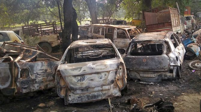 Charred vehicles set on fire by a mob in Monday's violent clashes over the alleged illegal slaughter of cattle in Bulandshahr. Photograph: PTI Photo