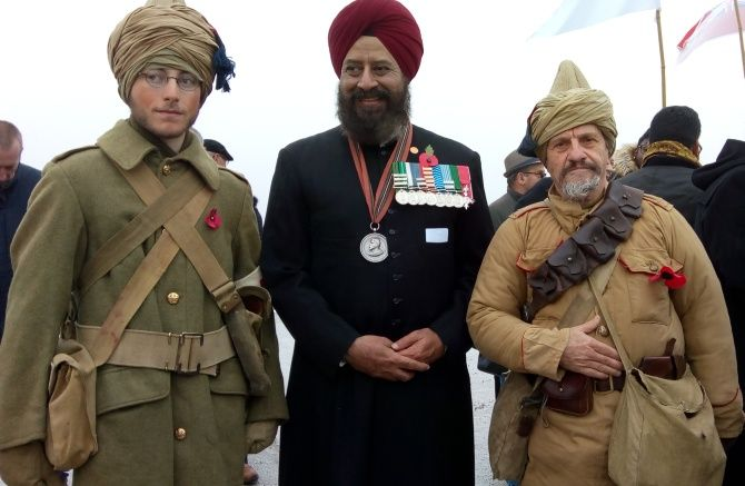 Squadron Leader Chhina at Villers Guislain with Frenchmen in uniforms Indian soldiers wore in the Great War enacting WWI battles.
