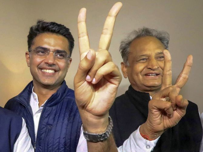 Congress leaders Sachin Pilot and Ashok Gehlot flash victory signs after the declaration of the Rajasthan assembly election results. Photograph: PTI Photo