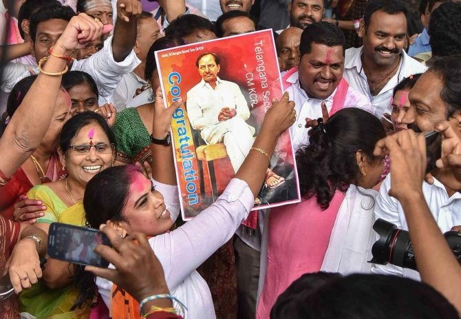 IMAGE: TRS workers celebrate their party's victory in the assembly election at Telangana Bhavan in Hyderabad, December 11, 2017. Photograph: PTI Photo