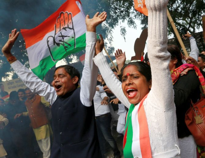 Congress workers celebrate the assembly results at the party headquarters in New Delhi. Photograph: Adnan Abidi/Reuters