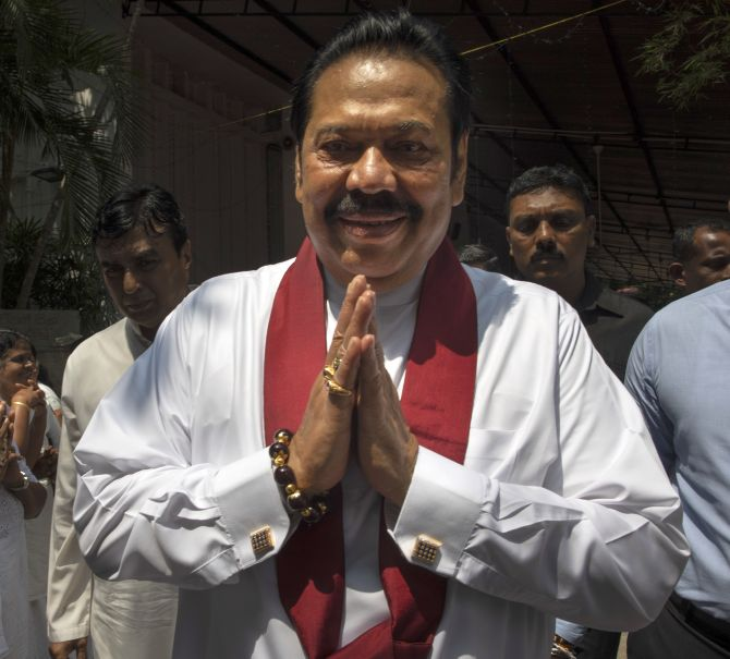 India News - Latest World & Political News - Current News Headlines in India - Rajapaksa resigns as Sri Lanka's PM, Wickremesinghe to be reinstated