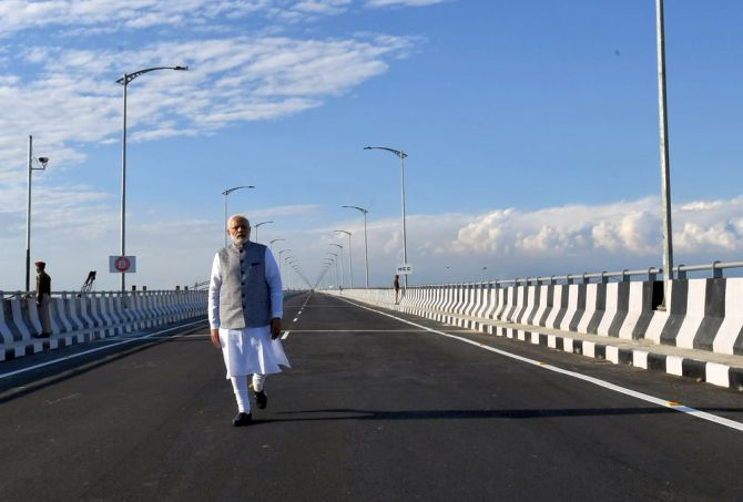 Prime Minister Narendra Damodardas Modi walks on India's longest rail-cum-road bridge over the Brahmaputra river in Bogibeel, Assam, which he inaugurated on December 25, 2018. Photograph: Press Information Bureau