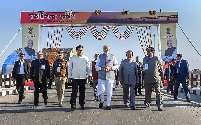 Prime Minister Narendra Damodardas Modi, flanked by Assam Governor Jagdish Mukhi to his left, and Chief Minister Sarbananda Sonowal, on the Bogibeel Bridge, the longest rail-cum-road bridge on the Brahmaputra river, after it was inaugurated, in Dibrugarh, December 25, 2018.