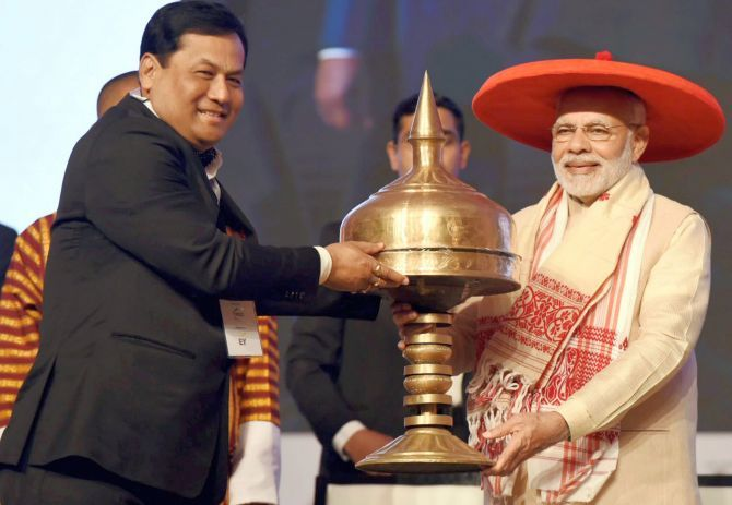 Prime Minister Narendra Damodardas Modi is felicitated by Assam Chief Minister Sarbananda Sonowal at the inauguration of the Advantage Assam programme at the Indira Gandhi Athletic Stadium, Guwahati, February 3, 2018. Photograph: PTI Photo