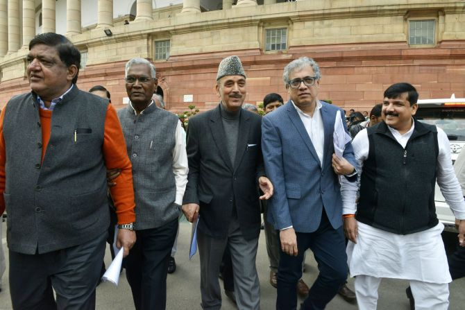 Samajwadi Party MP Naresh Agarwal, CPI leader D Raja, Congress MP Ghulam Nabi Azad, Trinamool Congress MP Derek O'Brien and AAP MP Sanjay Singh outside Parliament. Photograph: PTI Photo