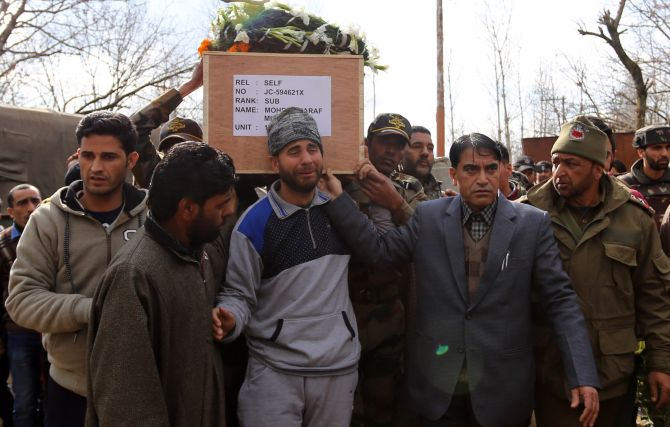 February 13, 2018: Family members, Indian Army soldiers and locals in Kupwara carry the body of JCO Mohammad Ashraf Mir, the Kashmiri soldier who was martyred in the terrorist attack at the Sunjuwan army camp attack. Photograph: Umar Ganie