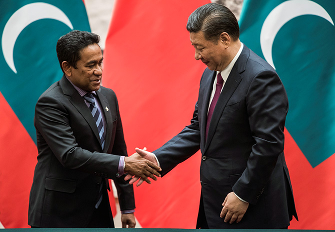 Maldives President Abdulla Yameen greets Chinese President Xi Jinping at the Great Hall of the People in Beijing, December 7, 2017. Photograph: Fred Dufour/Pool/Reuters