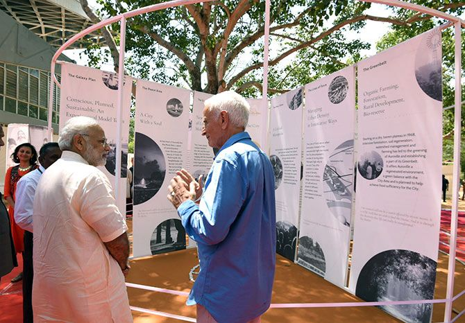 Prime Minister Narendra D Modi interacts with an old-timer at Auroville, February 25, 2018. Photograph: Press Information Bureau