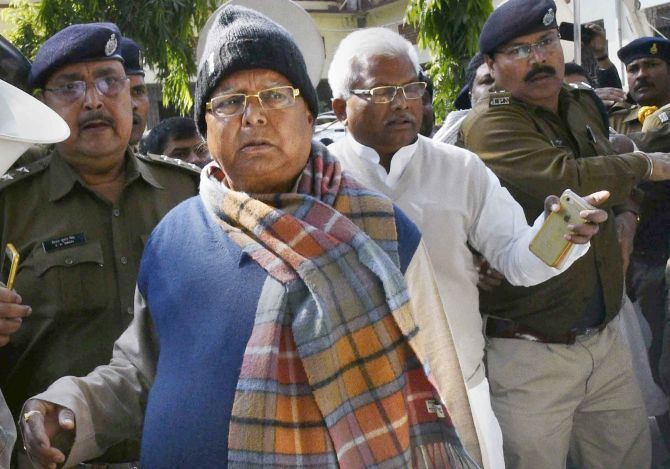 Rashtriya Janata Dal supremo Lalu Prasad Yadav, escorted by the police, after he appeared at the Special CBI court in Ranchi, January 6, 2018. Photograph: PTI Photo