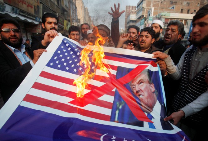Pakistanis burn a US flag and a picture of US President Donald J Trump at an anti-US rally in Peshawar, January 5, 2018. Photograph: Fayaz Aziz/Reuters
