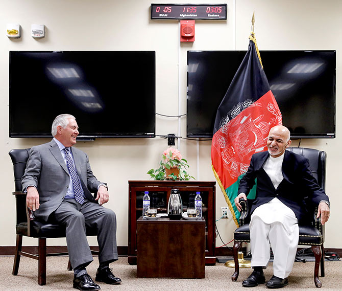 US Secretary of State Rex Tillerson, left, with Afghan President Ashraf Ghani at a meeting at Bagram air field, Afghanistan, October 23, 2017. Photograph:Alex Brandon/Pool/Reuters